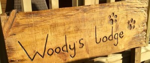 woodys lodge sign